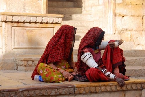 stock photo of two women in traditional dress in India
