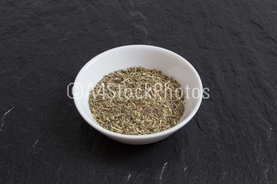 Provencal herbs in a bowl on a slate